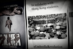 The posters supporting Hong Kong's Umbrella Revolution were reinstated in elevators within 12 hours.