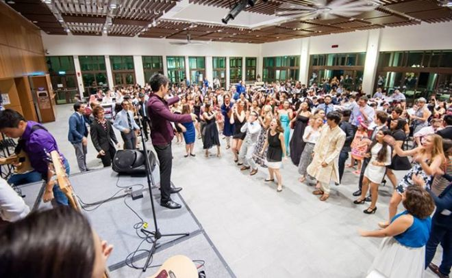 """Students, staff and faculty break out in spontaneous dance to """"A Community of Learning"""" at the formal dinner."""